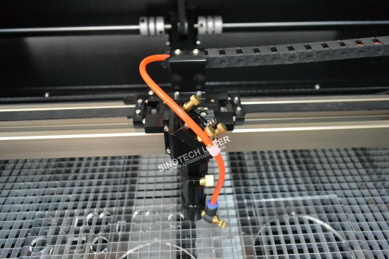 https://www.cnlasercutter.com/wp-content/uploads/2018/03/9060-compact-laser-cutting-machine.jpg